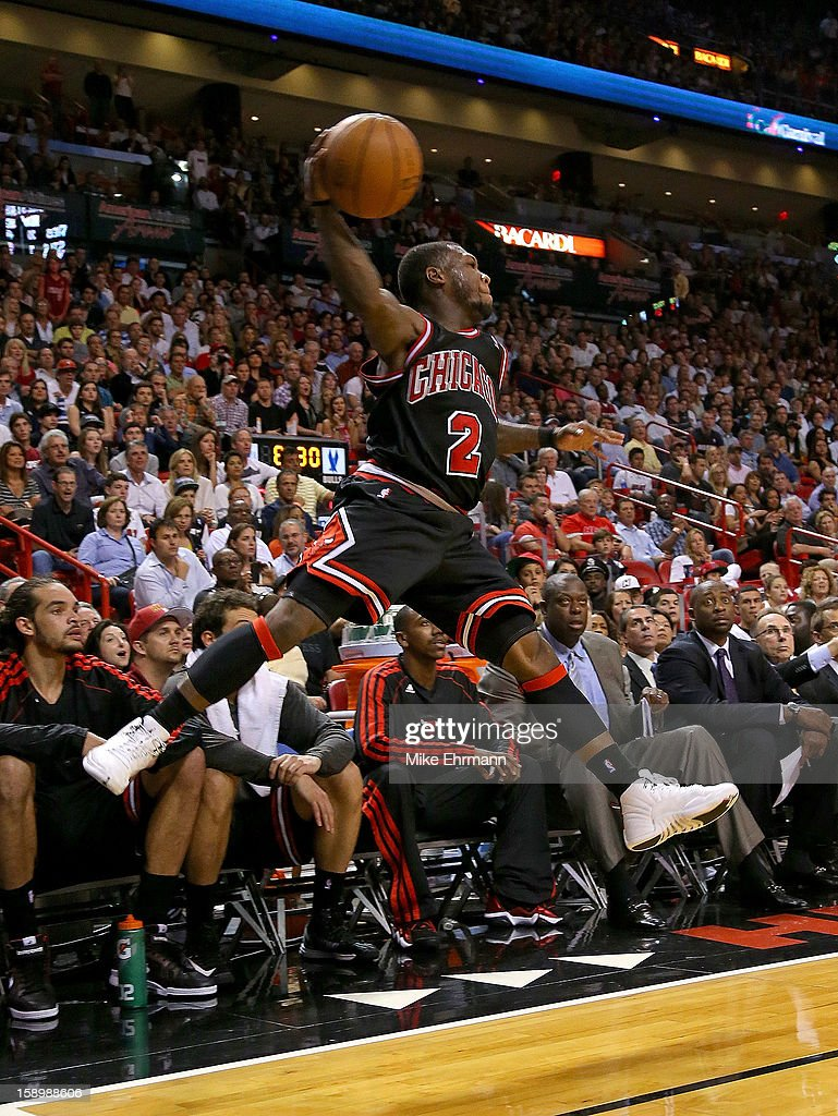 Nate Robinson #2 of the Chicago Bulls keeps the ball from goin out of bounds during a game against the Miami Heat at AmericanAirlines Arena on January 4, 2013 in Miami, Florida.