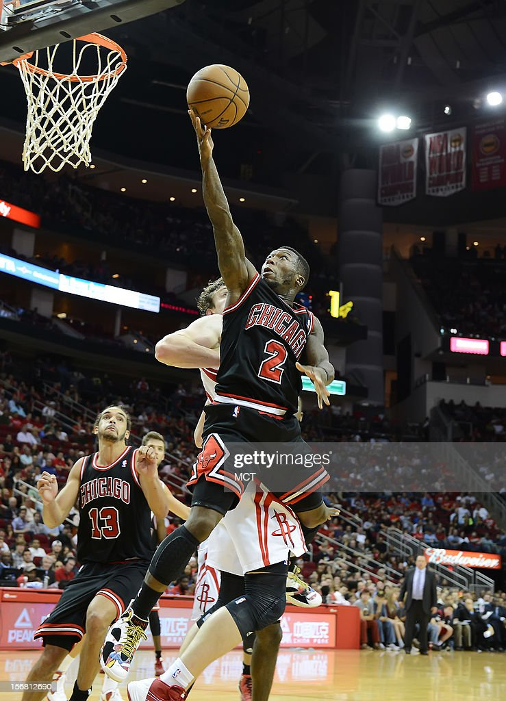 Nate Robinson (2) of the Chicago Bulls lays in a shot in front of Omer Asik (3) of the Houston Rockets in the second half of the Rockets' 93-89 victory on Wednesday, November 21, 2012, in Houston, Texas.