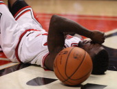Nate Robinson of the Chicago Bulls lays on the floor after being fouled while driving to the basket against the Brooklyn Nets in Game Six of the...