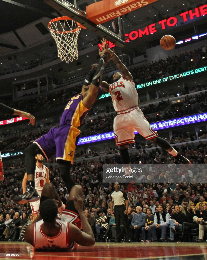 Nate Robinson #2 of the Chicago Bulls leaps to knock the ball away from Dwight Howard #12 of the Los Angeles Lakers at the United Center on January 21, 2013 in Chicago, Illinois.