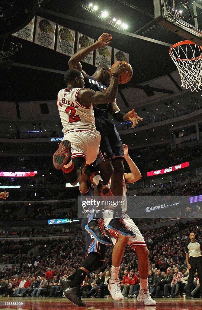 <a gi-track='captionPersonalityLinkClicked' href=/galleries/search?phrase=Nate+Robinson&family=editorial&specificpeople=208906 ng-click='$event.stopPropagation()'>Nate Robinson</a> #2 of the Chicago Bulls leaps to pass against <a gi-track='captionPersonalityLinkClicked' href=/galleries/search?phrase=Bismack+Biyombo&family=editorial&specificpeople=7640443 ng-click='$event.stopPropagation()'>Bismack Biyombo</a> #0 of the Charlotte Bobcats at the United Center on December 31, 2012 in Chicago, Illinois. The Bobcats defeated the Bulls 91-81.