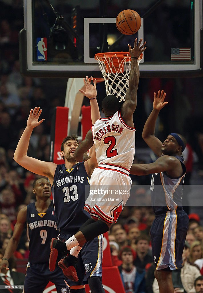 Nate Robinson #2 of the Chicago Bulls leaps to shoot over Marc Gasol #33 and Zach Randolph #50 of the Memphis Grizzles at the United Center on January 19, 2013 in Chicago, Illinois. The Grizzlies defeated the Bulls 85-82 in overtime.