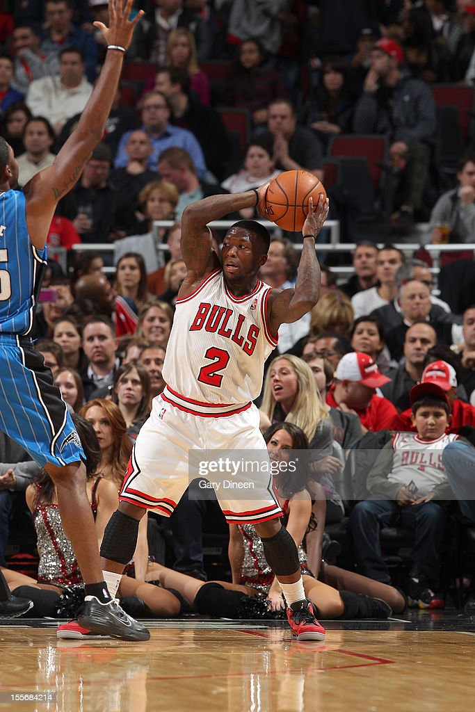 Nate Robinson #2 of the Chicago Bulls looks to pass against E'Twaun Moore #55 of the Orlando Magic during the NBA game on November 6, 2012 at the United Center in Chicago, Illinois.