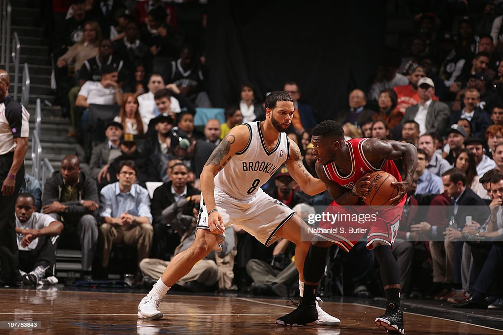 Nate Robinson #2 of the Chicago Bulls looks to pass the ball Deron Williams #8 against the Brooklyn Nets in Game Five of the Eastern Conference Quarterfinals during the 2013 NBA Playoffs on April 29 at the Barclays Center in the Brooklyn borough of New York City.