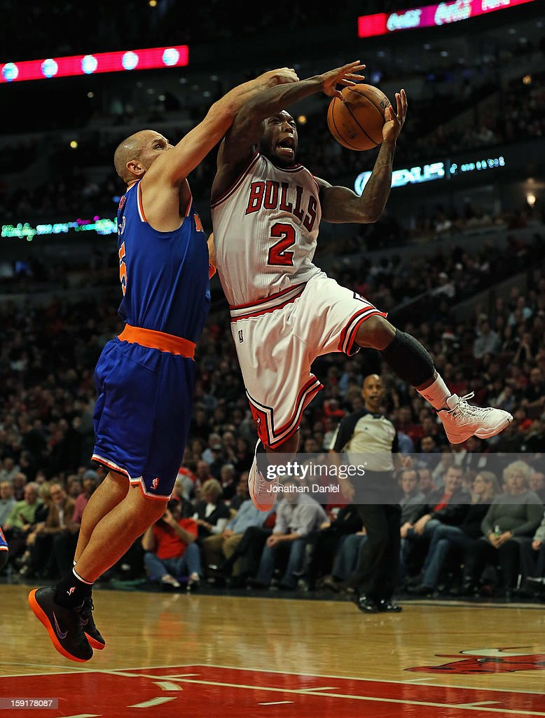<a gi-track='captionPersonalityLinkClicked' href=/galleries/search?phrase=Nate+Robinson&family=editorial&specificpeople=208906 ng-click='$event.stopPropagation()'>Nate Robinson</a> #2 of the Chicago Bulls looses control of the ball under pressure from <a gi-track='captionPersonalityLinkClicked' href=/galleries/search?phrase=Jason+Kidd&family=editorial&specificpeople=201560 ng-click='$event.stopPropagation()'>Jason Kidd</a> #5 of the New York Knicks at the United Center on December 8, 2012 in Chicago, Illinois. The Bulls defeated the Knicks 93-85.