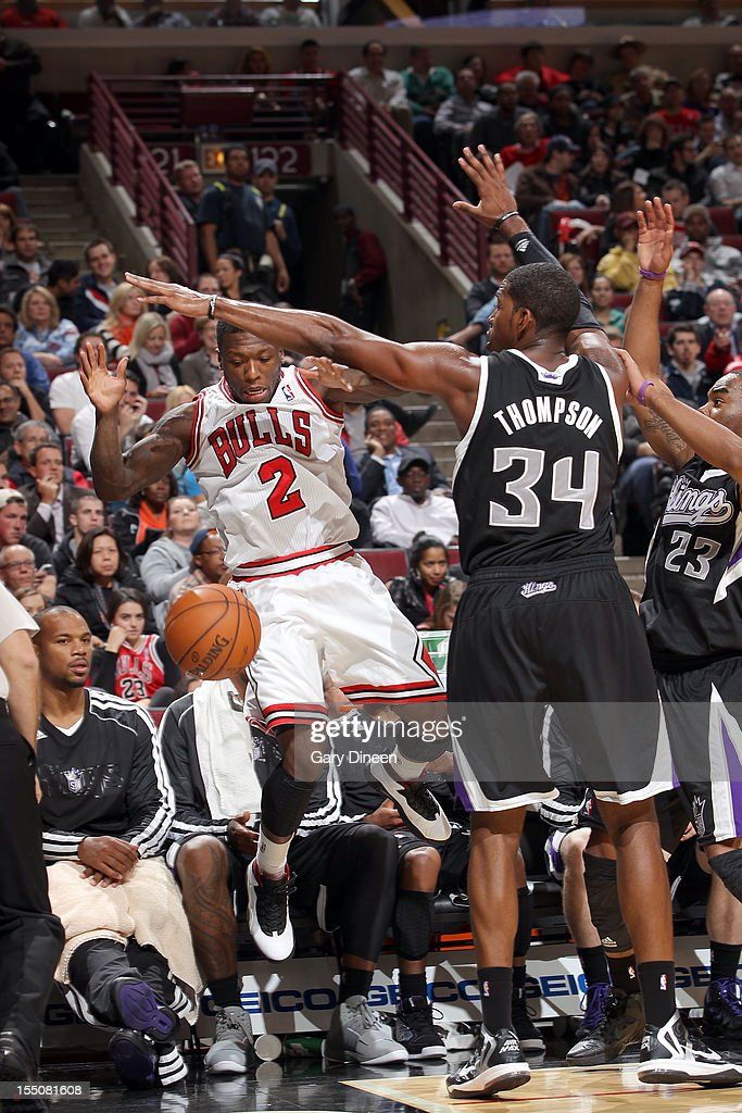 Nate Robinson #2 of the Chicago Bulls loses the ball against Jason Thompson #34 of the Sacramento Kings during the NBA game on October 31, 2012 at the United Center in Chicago, Illinois.