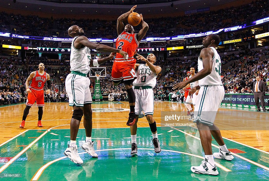 Nate Robinson #2 of the Chicago Bulls loses the ball midair as he drives to the basket in front of Kevin Garnett #5 of the Boston Celtics during the game on February 13, 2013 at TD Garden in Boston, Massachusetts.