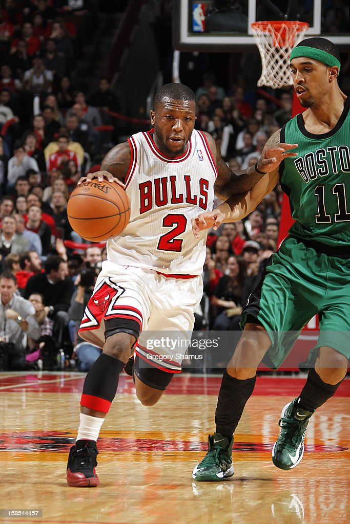 Nate Robinson #2 of the Chicago Bulls moves the ball past Courtney Lee #11 of the Boston Celtics on December 18, 2012 at the United Center in Chicago, Illinois.