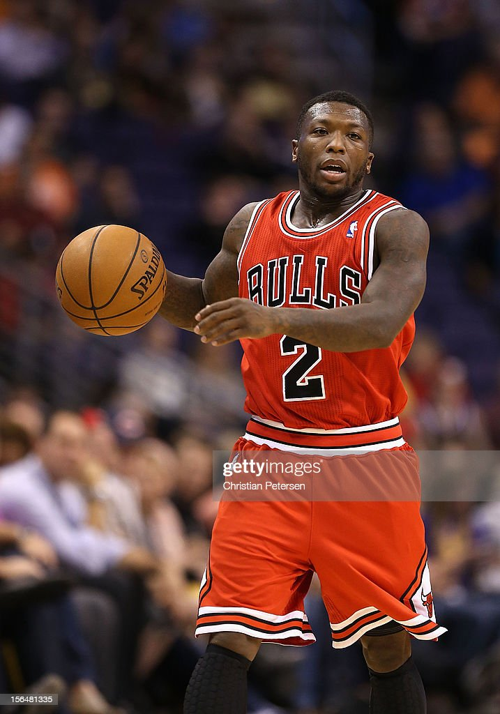 Nate Robinson #2 of the Chicago Bulls moves the ball upcourt during the NBA game against the Phoenix Suns at US Airways Center on November 14, 2012 in Phoenix, Arizona. The Bulls defeated the Suns 112-106 in overtime.