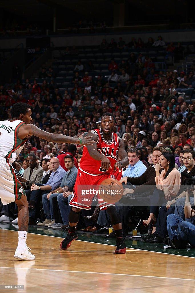 Nate Robinson #2 of the Chicago Bulls passes against Brandon Jennings #3 of the Milwaukee Bucks during the NBA game on November 24, 2012 at the BMO Harris Bradley Center in Milwaukee, Wisconsin.