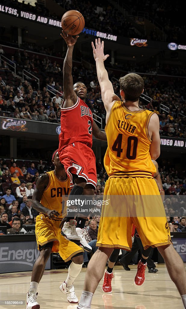 <a gi-track='captionPersonalityLinkClicked' href=/galleries/search?phrase=Nate+Robinson&family=editorial&specificpeople=208906 ng-click='$event.stopPropagation()'>Nate Robinson</a> #2 of the Chicago Bulls puts up the shot against <a gi-track='captionPersonalityLinkClicked' href=/galleries/search?phrase=Tyler+Zeller&family=editorial&specificpeople=5122156 ng-click='$event.stopPropagation()'>Tyler Zeller</a> #40 of the Cleveland Cavaliers at The Quicken Loans Arena on November 2, 2012 in Cleveland, Ohio.