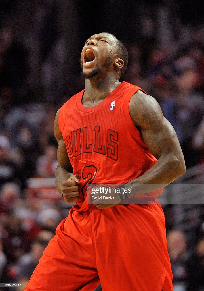 Nate Robinson #2 of the Chicago Bulls reacts after making a basket against the Houston Rockets on December 25, 2012 at the United Center in Chicago, Illinois. The Houston Rockets defeated the Chicago Bulls 120-97.