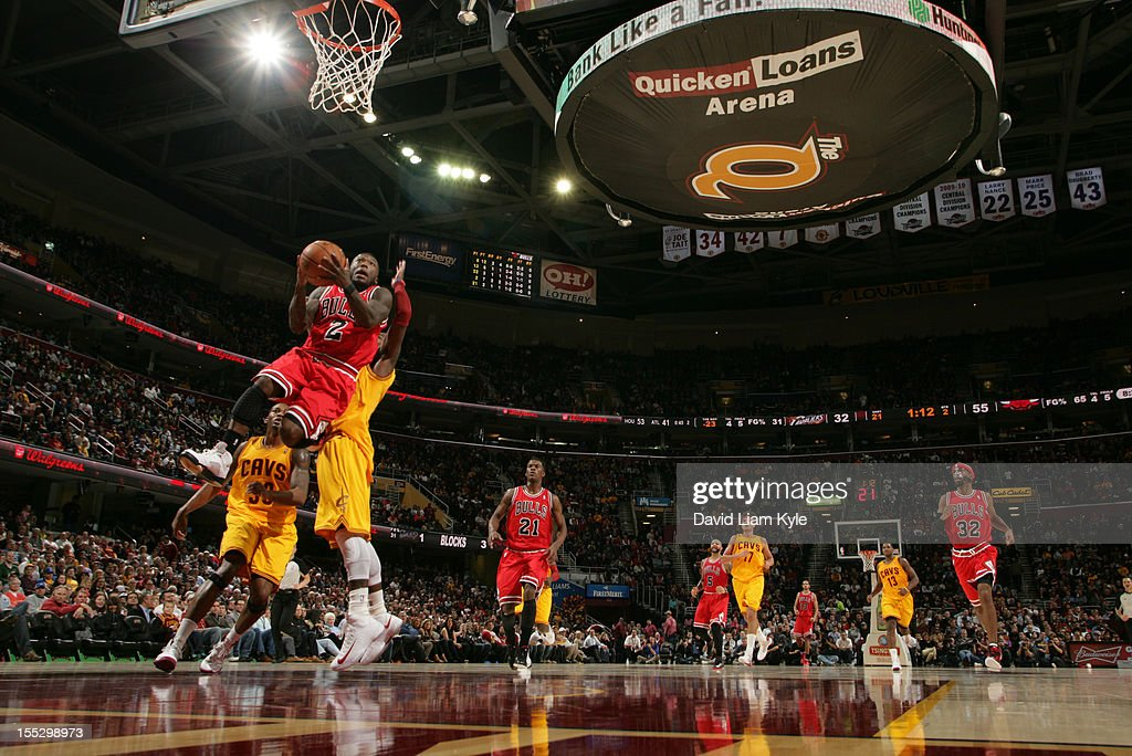 <a gi-track='captionPersonalityLinkClicked' href=/galleries/search?phrase=Nate+Robinson&family=editorial&specificpeople=208906 ng-click='$event.stopPropagation()'>Nate Robinson</a> #2 of the Chicago Bulls rises up for the shot against <a gi-track='captionPersonalityLinkClicked' href=/galleries/search?phrase=Alonzo+Gee&family=editorial&specificpeople=801443 ng-click='$event.stopPropagation()'>Alonzo Gee</a> #33 and <a gi-track='captionPersonalityLinkClicked' href=/galleries/search?phrase=Kyrie+Irving&family=editorial&specificpeople=6893971 ng-click='$event.stopPropagation()'>Kyrie Irving</a> #2 of the Cleveland Cavaliers at The Quicken Loans Arena on November 2, 2012 in Cleveland, Ohio.