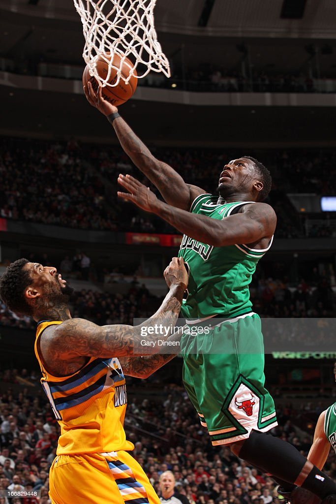 <a gi-track='captionPersonalityLinkClicked' href=/galleries/search?phrase=Nate+Robinson&family=editorial&specificpeople=208906 ng-click='$event.stopPropagation()'>Nate Robinson</a> #2 of the Chicago Bulls shoots a layup against <a gi-track='captionPersonalityLinkClicked' href=/galleries/search?phrase=Wilson+Chandler&family=editorial&specificpeople=809324 ng-click='$event.stopPropagation()'>Wilson Chandler</a> #21 of the Denver Nuggets on March 18, 2013 at the United Center in Chicago, Illinois.