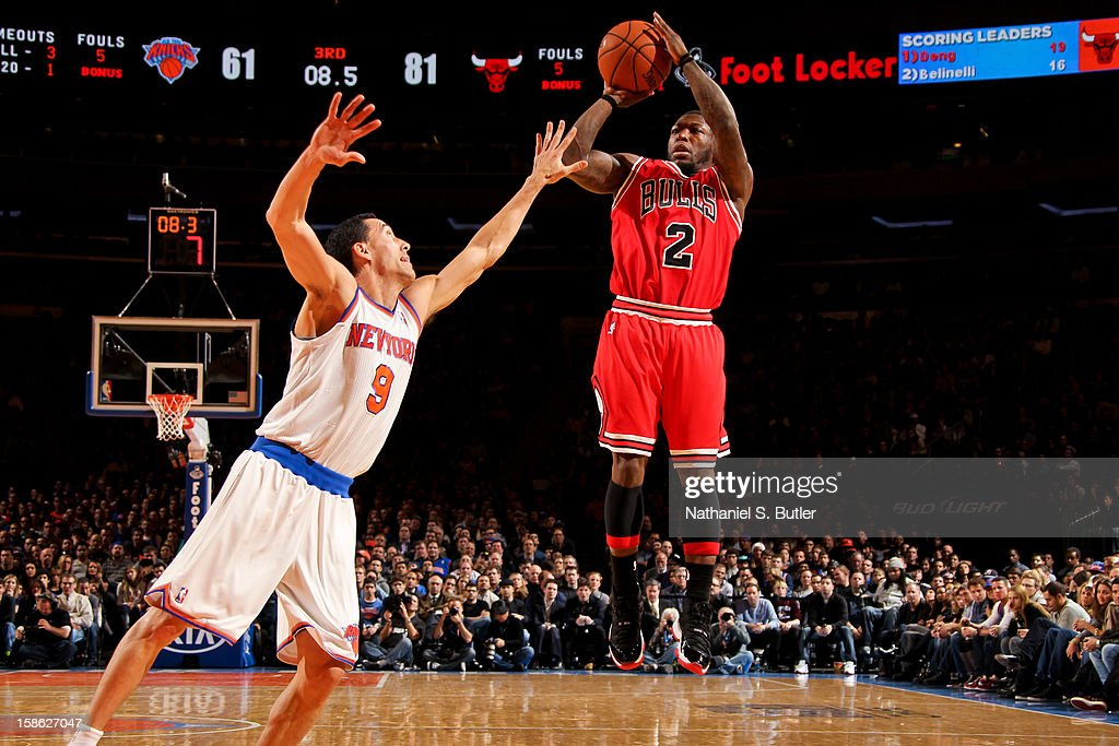 Nate Robinson #2 of the Chicago Bulls shoots a three-pointer against Pablo Prigioni #9 of the New York Knicks on December 21, 2012 at Madison Square Garden in New York City.