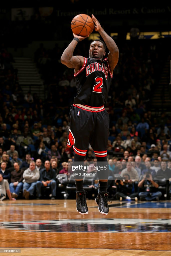 Nate Robinson #2 of the Chicago Bulls shoots a three-pointer against the Minnesota Timberwolves on March 24, 2013 at Target Center in Minneapolis, Minnesota.
