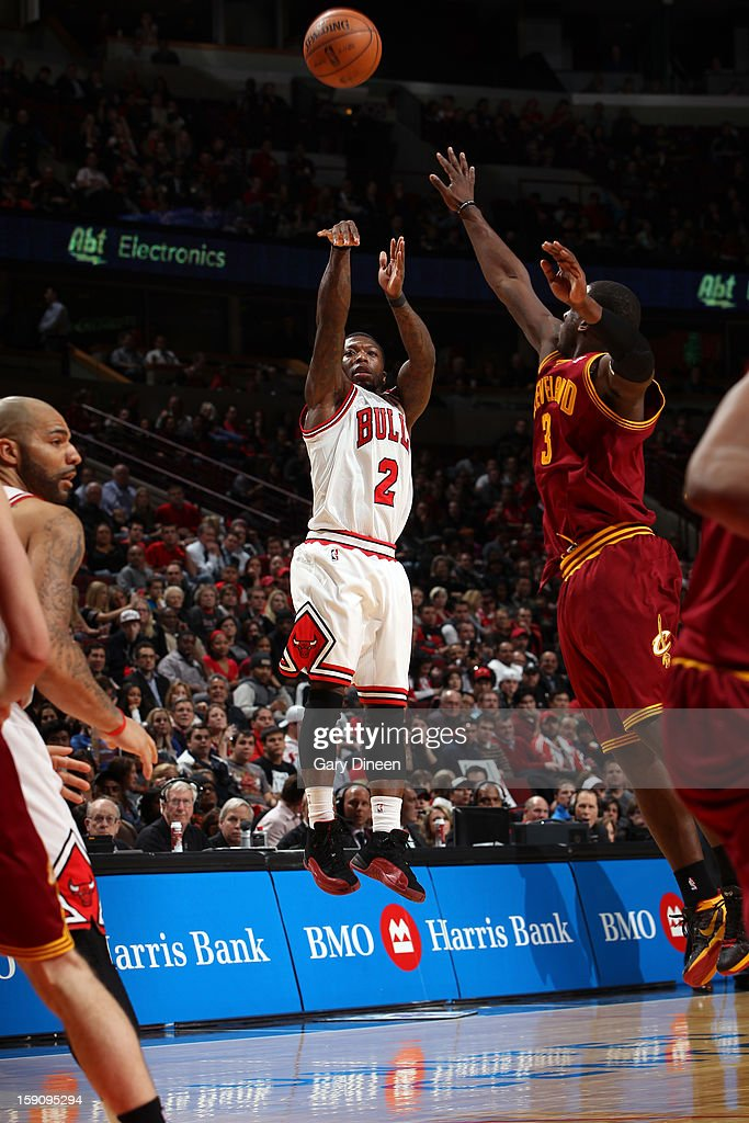 <a gi-track='captionPersonalityLinkClicked' href=/galleries/search?phrase=Nate+Robinson&family=editorial&specificpeople=208906 ng-click='$event.stopPropagation()'>Nate Robinson</a> #2 of the Chicago Bulls shoots against <a gi-track='captionPersonalityLinkClicked' href=/galleries/search?phrase=Dion+Waiters&family=editorial&specificpeople=6902921 ng-click='$event.stopPropagation()'>Dion Waiters</a> #3 of the Cleveland Cavaliers on January 7, 2013 at the United Center in Chicago, Illinois.
