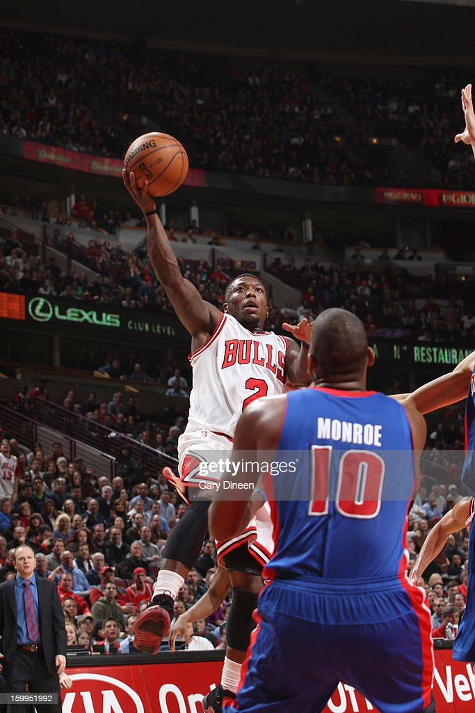 Nate Robinson #2 of the Chicago Bulls shoots against Greg Monroe #10 of the Detroit Pistons on January 23, 2012 at the United Center in Chicago, Illinois.