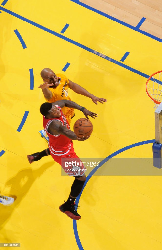 <a gi-track='captionPersonalityLinkClicked' href=/galleries/search?phrase=Nate+Robinson&family=editorial&specificpeople=208906 ng-click='$event.stopPropagation()'>Nate Robinson</a> #2 of the Chicago Bulls shoots against <a gi-track='captionPersonalityLinkClicked' href=/galleries/search?phrase=Jarrett+Jack&family=editorial&specificpeople=208109 ng-click='$event.stopPropagation()'>Jarrett Jack</a> #2 of the Golden State Warriors on March 15, 2013 at Oracle Arena in Oakland, California.