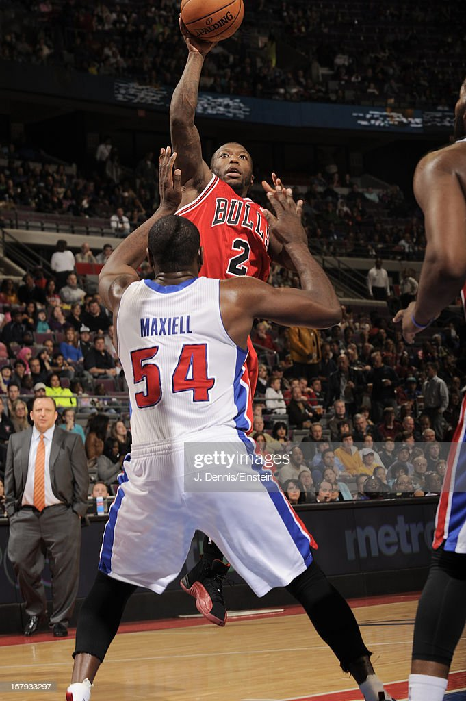 Nate Robinson #2 of the Chicago Bulls shoots against Jason Maxiell #54 of the Detroit Pistons on December 7, 2012 at The Palace of Auburn Hills in Auburn Hills, Michigan.