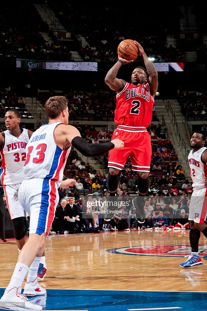 <a gi-track='captionPersonalityLinkClicked' href=/galleries/search?phrase=Nate+Robinson&family=editorial&specificpeople=208906 ng-click='$event.stopPropagation()'>Nate Robinson</a> #2 of the Chicago Bulls shoots against Jonas Jerebko #33 of the Detroit Pistons on April 7, 2013 at The Palace of Auburn Hills in Auburn Hills, Michigan.