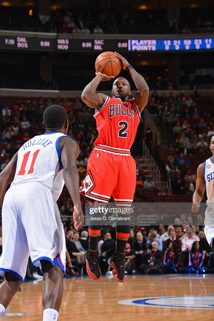 <a gi-track='captionPersonalityLinkClicked' href=/galleries/search?phrase=Nate+Robinson&family=editorial&specificpeople=208906 ng-click='$event.stopPropagation()'>Nate Robinson</a> #2 of the Chicago Bulls shoots against <a gi-track='captionPersonalityLinkClicked' href=/galleries/search?phrase=Jrue+Holiday&family=editorial&specificpeople=5042484 ng-click='$event.stopPropagation()'>Jrue Holiday</a> #11 of the Philadelphia 76ers on December 12, 2012 at the Wells Fargo Center in Philadelphia, Pennsylvania.