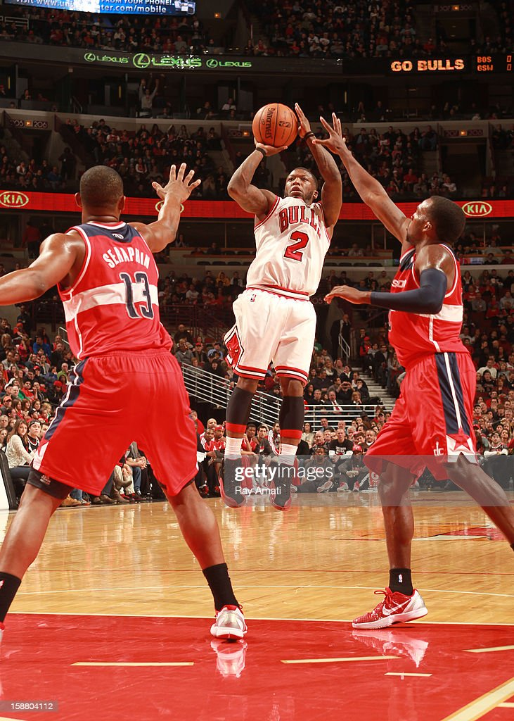 Nate Robinson #2 of the Chicago Bulls shoots against Kevin Seraphin #13 and Shelvin Mack #22 of the Washington Wizards on December 29, 2012 at the United Center in Chicago, Illinois.