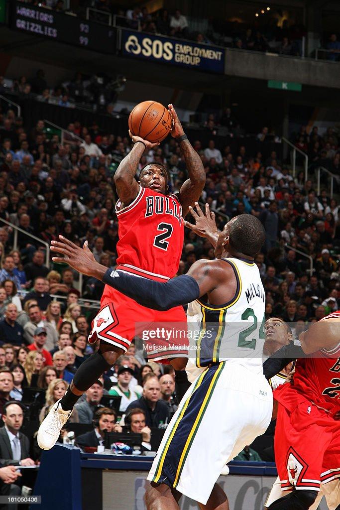 Nate Robinson #2 of the Chicago Bulls shoots against Paul Millsap #24 of the Utah Jazz at Energy Solutions Arena on February 08, 2013 in Salt Lake City, Utah.