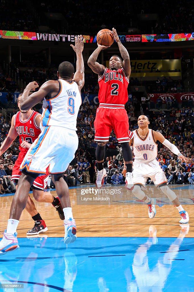 Nate Robinson #2 of the Chicago Bulls shoots against Serge Ibaka #9 of the Oklahoma City Thunder on February 24, 2013 at the Chesapeake Energy Arena in Oklahoma City, Oklahoma.