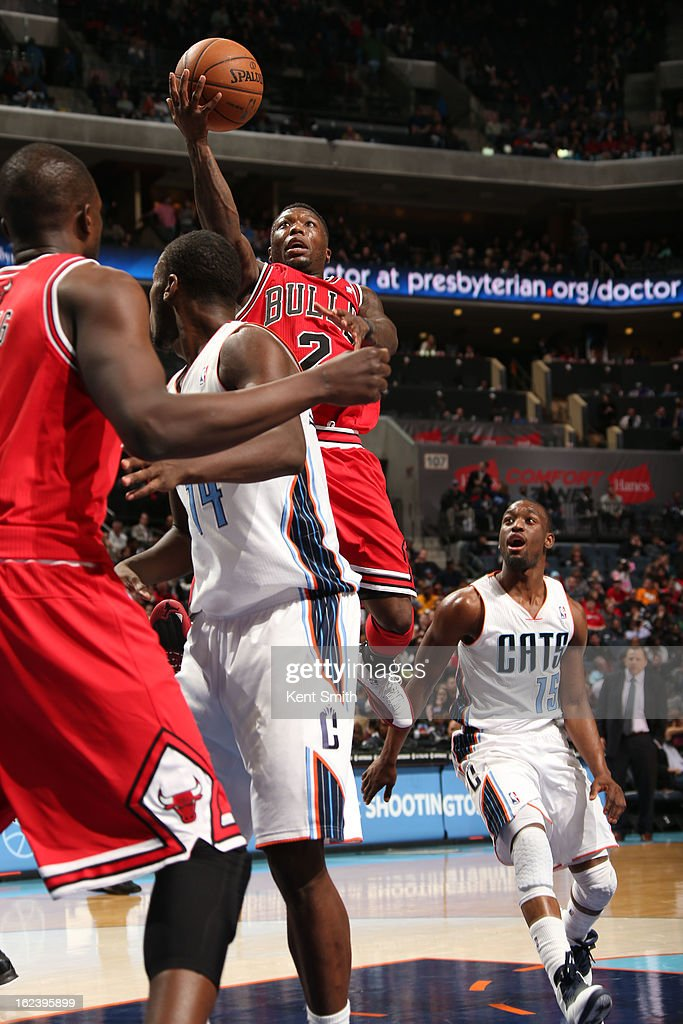 <a gi-track='captionPersonalityLinkClicked' href=/galleries/search?phrase=Nate+Robinson&family=editorial&specificpeople=208906 ng-click='$event.stopPropagation()'>Nate Robinson</a> #2 of the Chicago Bulls shoots against the Charlotte Bobcats at the Time Warner Cable Arena on February 22, 2013 in Charlotte, North Carolina.