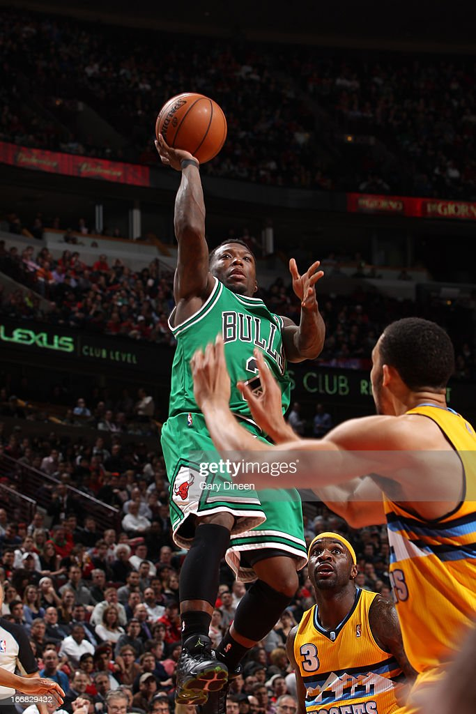 <a gi-track='captionPersonalityLinkClicked' href=/galleries/search?phrase=Nate+Robinson&family=editorial&specificpeople=208906 ng-click='$event.stopPropagation()'>Nate Robinson</a> #2 of the Chicago Bulls shoots against the Denver Nuggets on March 18, 2013 at the United Center in Chicago, Illinois.