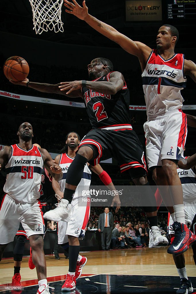 Nate Robinson #2 of the Chicago Bulls shoots against Trevor Ariza #1 of the Washington Wizards during the game at the Verizon Center on January 26, 2013 in Washington, DC.