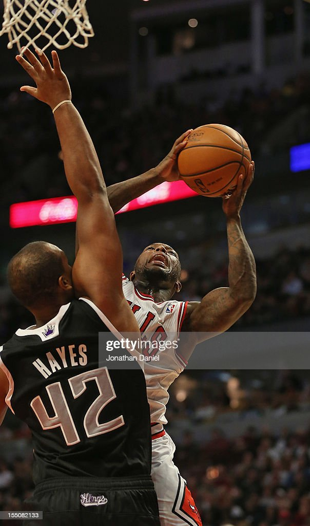 <a gi-track='captionPersonalityLinkClicked' href=/galleries/search?phrase=Nate+Robinson&family=editorial&specificpeople=208906 ng-click='$event.stopPropagation()'>Nate Robinson</a> #2 of the Chicago Bulls shoots over <a gi-track='captionPersonalityLinkClicked' href=/galleries/search?phrase=Chuck+Hayes&family=editorial&specificpeople=206129 ng-click='$event.stopPropagation()'>Chuck Hayes</a> #42 of the Sacramento Kings at the United Center on October 31, 2012 in Chicago, Illinois. The Bulls defeated the Kings 93-87.