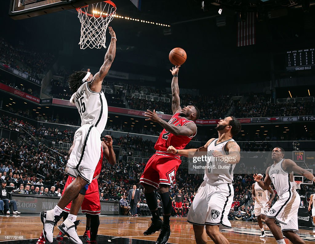 Nate Robinson #2 of the Chicago Bulls shoots over Gerald Wallace #45 of the Brooklyn Nets in Game Five of the Eastern Conference Quarterfinals during the 2013 NBA Playoffs on April 29 at the Barclays Center in the Brooklyn borough of New York City.