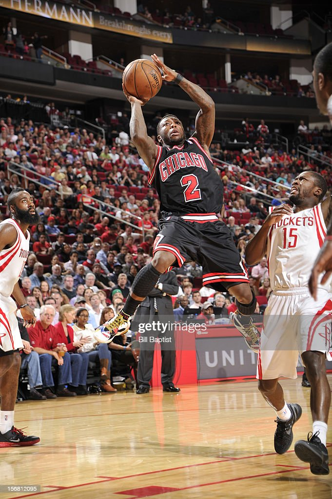 Nate Robinson #2 of the Chicago Bulls shoots the ball over Toney Douglas #15 of the Houston Rockets on November 21, 2012 at the Toyota Center in Houston, Texas.