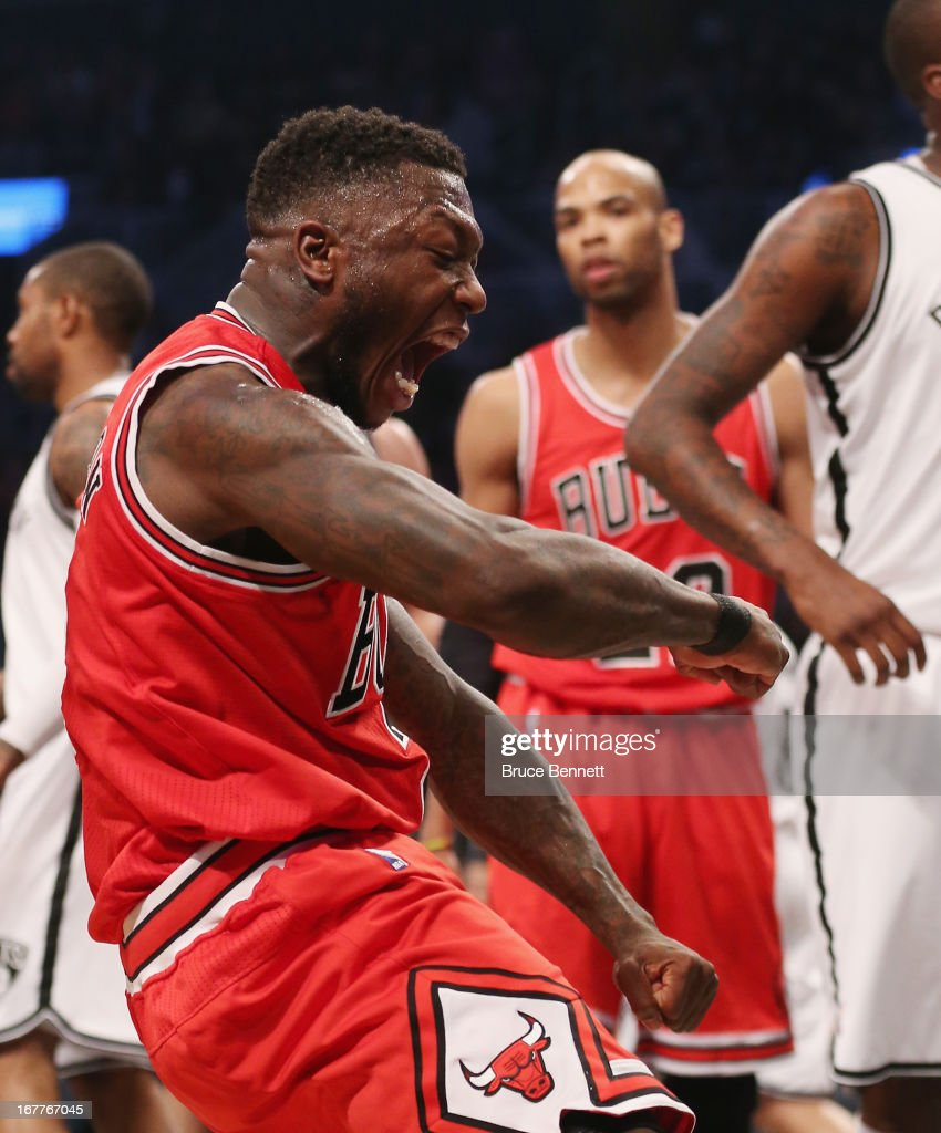 <a gi-track='captionPersonalityLinkClicked' href=/galleries/search?phrase=Nate+Robinson&family=editorial&specificpeople=208906 ng-click='$event.stopPropagation()'>Nate Robinson</a> #2 of the Chicago Bulls sinks a basket and draws a fould against the Brooklyn Nets during Game Five of the Eastern Conference Quarterfinals of the 2013 NBA Playoffs at the Barclays Center on April 29, 2013 in New York City.