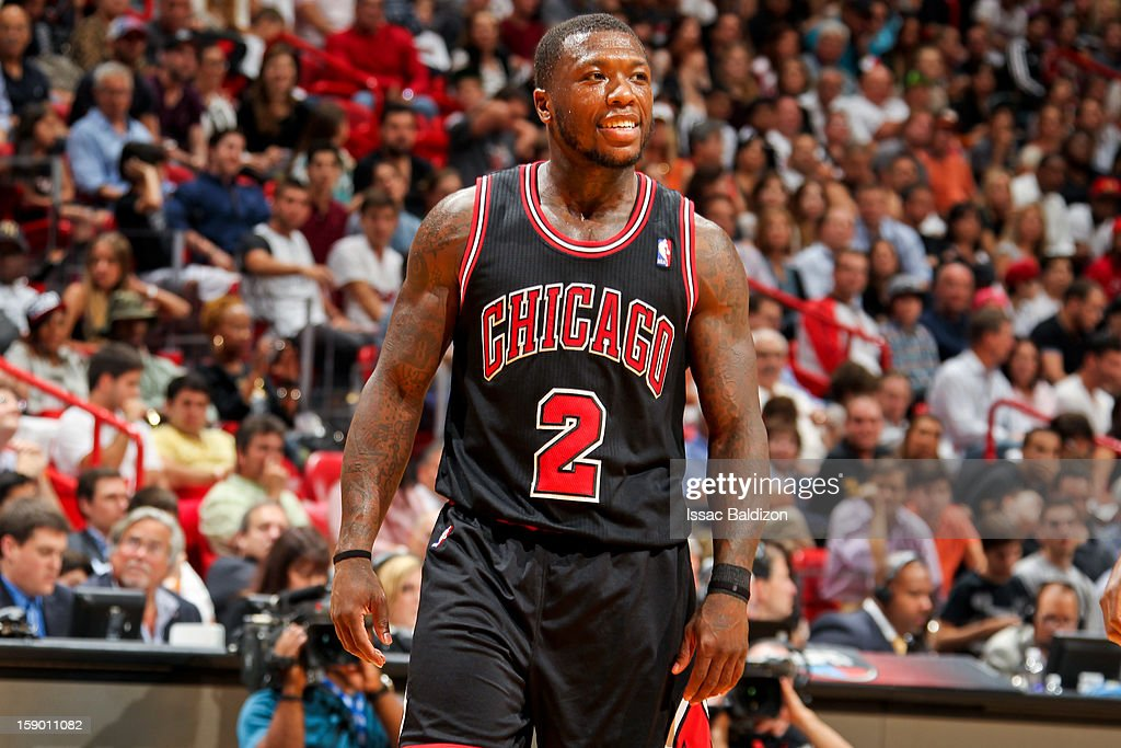 Nate Robinson #2 of the Chicago Bulls smiles while playing against the Miami Heat on January 4, 2013 at American Airlines Arena in Miami, Florida.