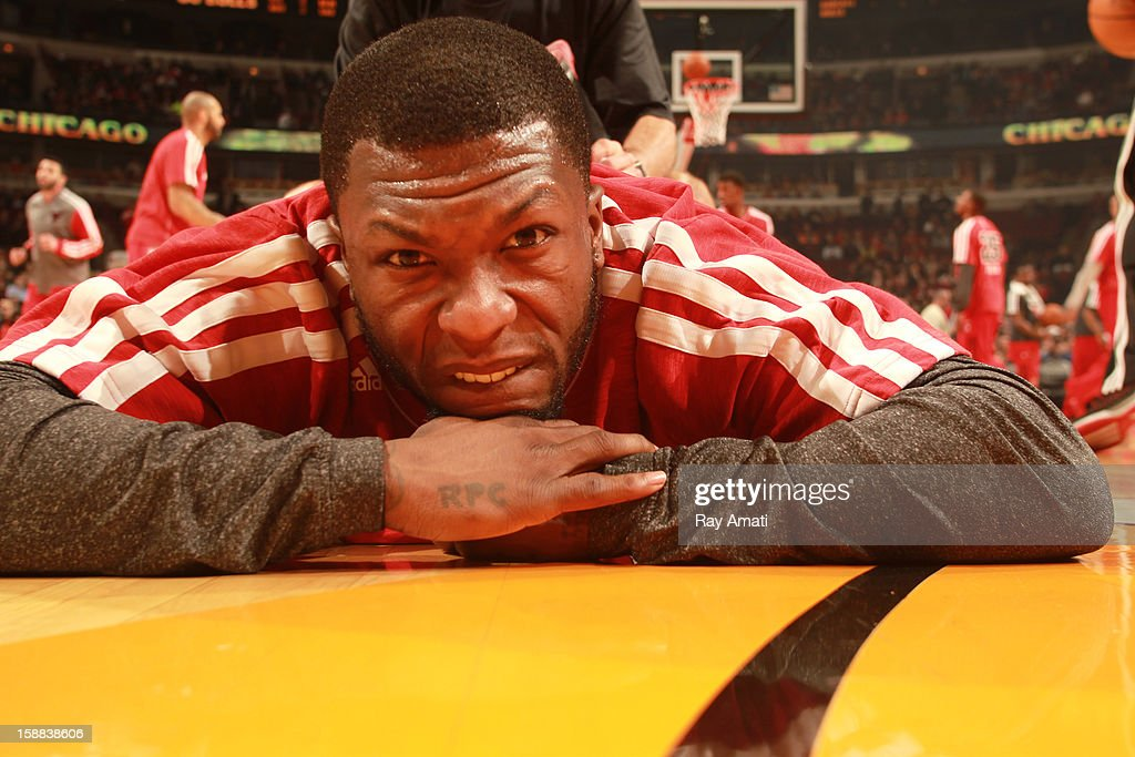 Nate Robinson #2 of the Chicago Bulls stretches prior to the start of the game against the Charlotte Bobcats on December 31, 2012 at the United Center in Chicago, Illinois.