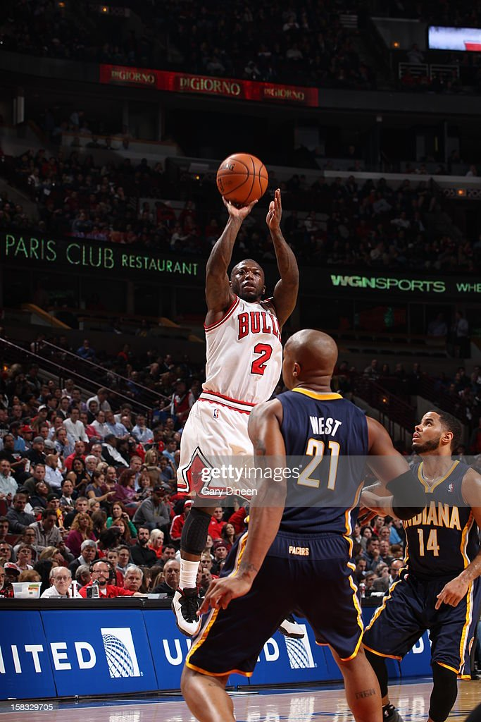<a gi-track='captionPersonalityLinkClicked' href=/galleries/search?phrase=Nate+Robinson&family=editorial&specificpeople=208906 ng-click='$event.stopPropagation()'>Nate Robinson</a> #2 of the Chicago Bulls takes a shot over David West #21 of the Indiana Pacers on December 4, 2012 at the United Center in Chicago, Illinois.