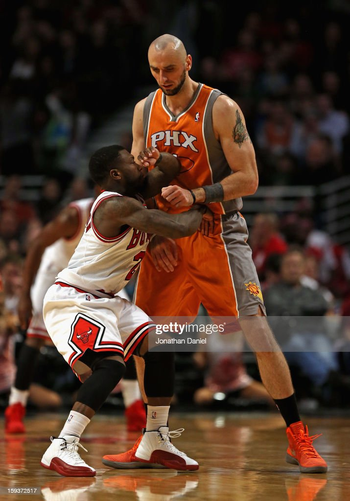 <a gi-track='captionPersonalityLinkClicked' href=/galleries/search?phrase=Nate+Robinson&family=editorial&specificpeople=208906 ng-click='$event.stopPropagation()'>Nate Robinson</a> #2 of the Chicago Bulls tries to move through a screen set by <a gi-track='captionPersonalityLinkClicked' href=/galleries/search?phrase=Marcin+Gortat&family=editorial&specificpeople=589986 ng-click='$event.stopPropagation()'>Marcin Gortat</a> #4 of the Phoenix Suns at the United Center on January 12, 2013 in Chicago, Illinois. The Suns defeated the Bulls 97-81.