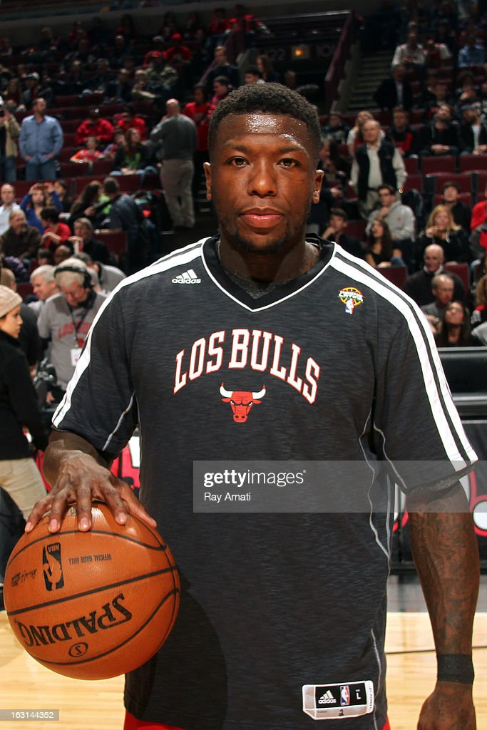 <a gi-track='captionPersonalityLinkClicked' href=/galleries/search?phrase=Nate+Robinson&family=editorial&specificpeople=208906 ng-click='$event.stopPropagation()'>Nate Robinson</a> #2 of the Chicago Bulls warms up before the game against the Brooklyn Nets on March 2, 2013 at the United Center in Chicago, Illinois.