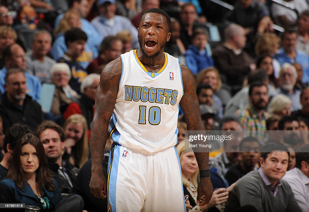 <a gi-track='captionPersonalityLinkClicked' href=/galleries/search?phrase=Nate+Robinson&family=editorial&specificpeople=208906 ng-click='$event.stopPropagation()'>Nate Robinson</a> #10 of the Denver Nuggets celebrates a play against the Atlanta Hawks on November 7, 2013 at the Pepsi Center in Denver, Colorado.