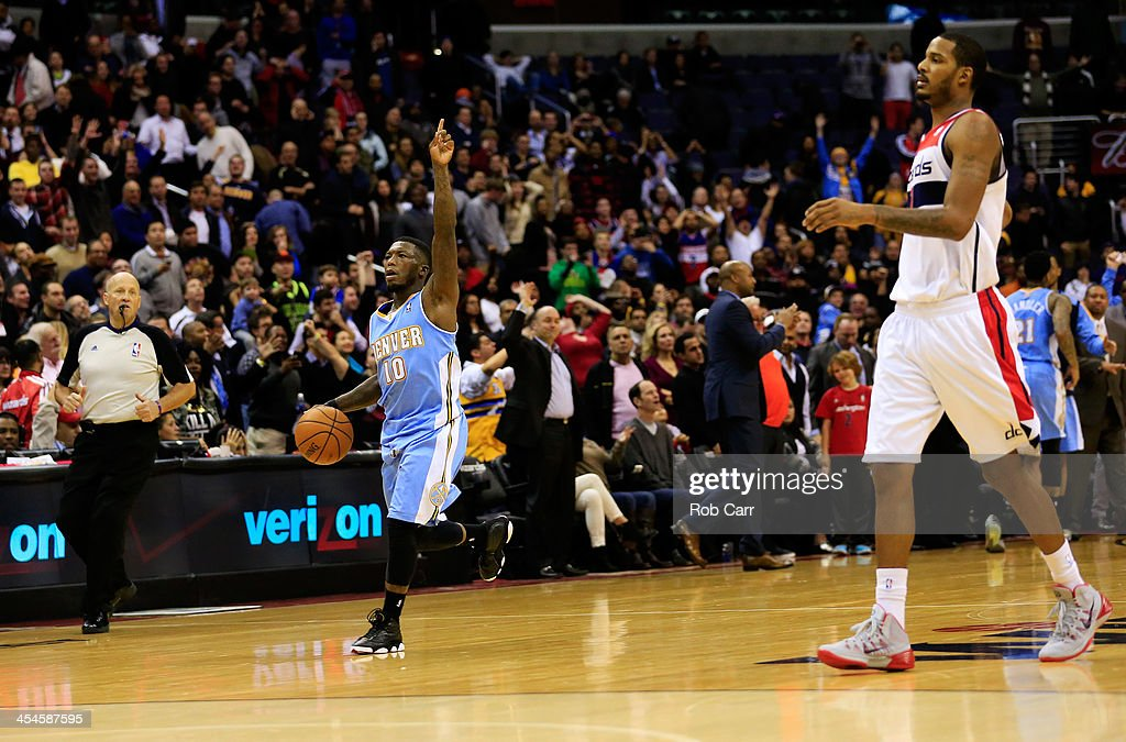 <a gi-track='captionPersonalityLinkClicked' href=/galleries/search?phrase=Nate+Robinson&family=editorial&specificpeople=208906 ng-click='$event.stopPropagation()'>Nate Robinson</a> #10 of the Denver Nuggets celebrates as <a gi-track='captionPersonalityLinkClicked' href=/galleries/search?phrase=Trevor+Ariza&family=editorial&specificpeople=201708 ng-click='$event.stopPropagation()'>Trevor Ariza</a> #1 of the Washington Wizards walks off the floor after the Nuggets defeated the Wizards 75-74 at Verizon Center on December 9, 2013 in Washington, DC.