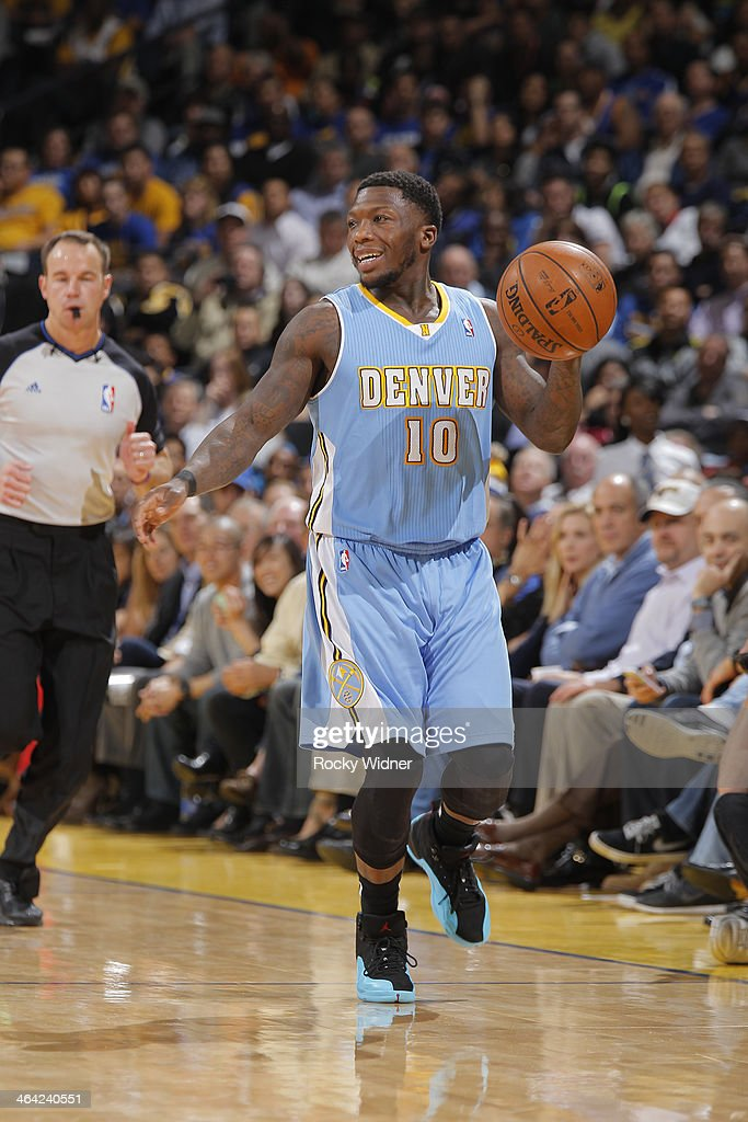 Nate Robinson #10 of the Denver Nuggets dribbles against the Golden State Warriors on January 15, 2014 at Oracle Arena in Oakland, California.