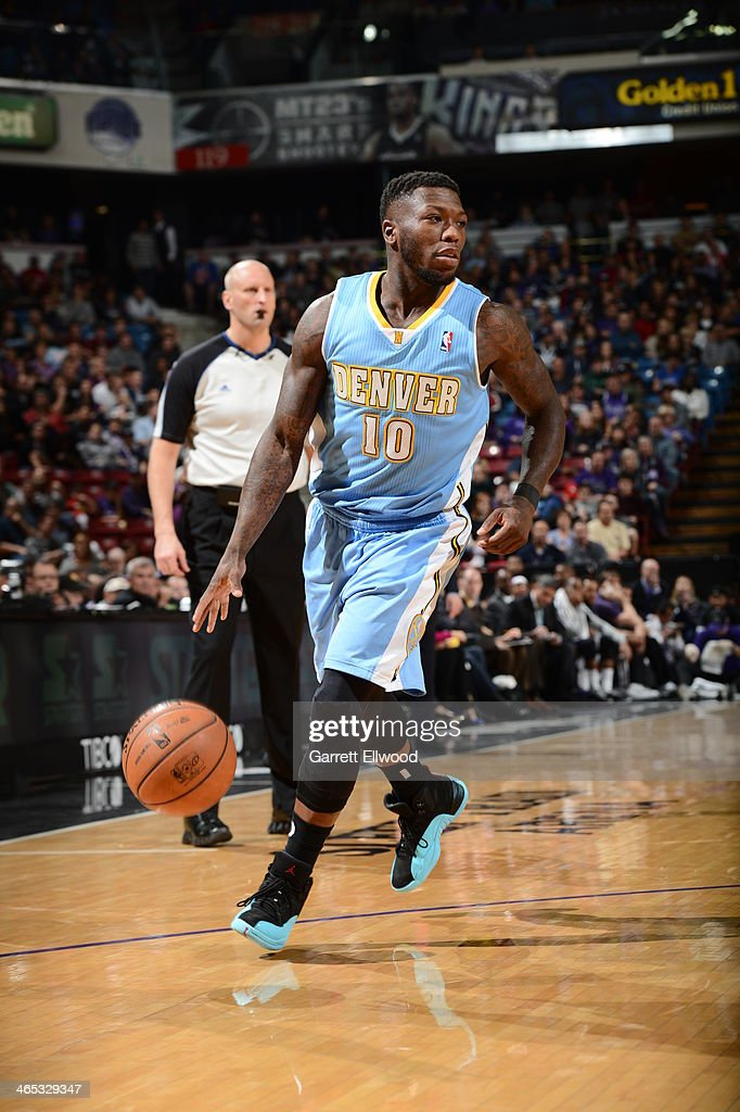 Nate Robinson #10 of the Denver Nuggets dribbles the ball up the court against the Sacramento Kings at Sleep Train Arena on January 26, 2014 in Sacramento, California.