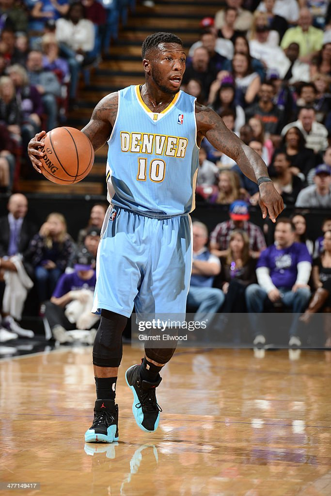 Nate Robinson #10 of the Denver Nuggets dribbles up the court while giving direction to his team against the Sacramento Kings at Sleep Train Arena on January 26, 2014 in Sacramento, California.