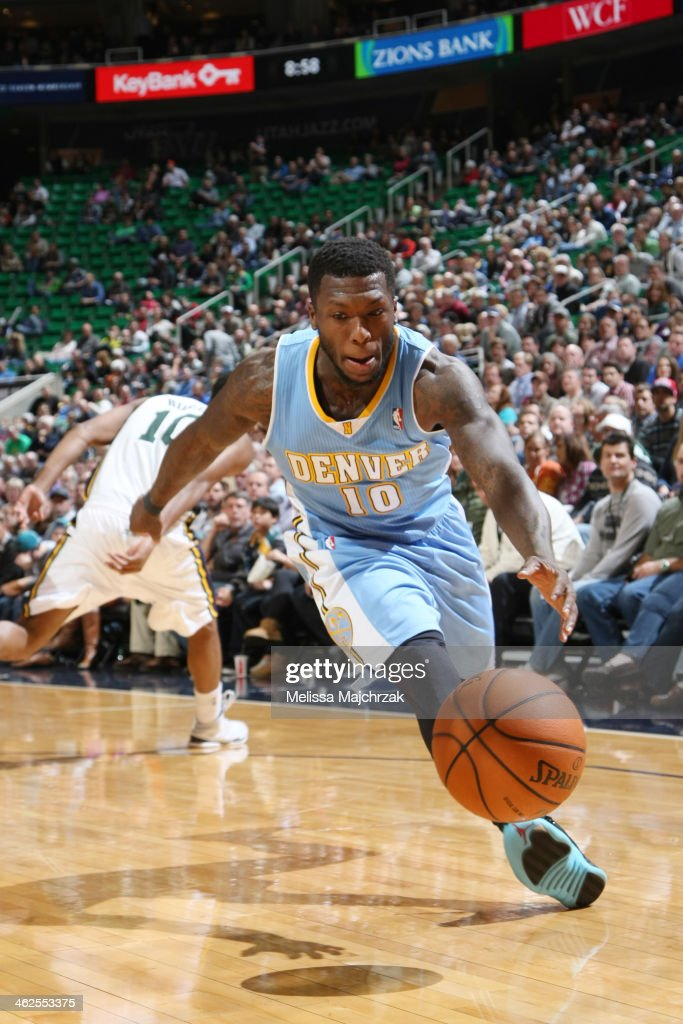 Nate Robinson #10 of the Denver Nuggets drives against the Utah Jazz at EnergySolutions Arena on January 13, 2014 in Salt Lake City, Utah.
