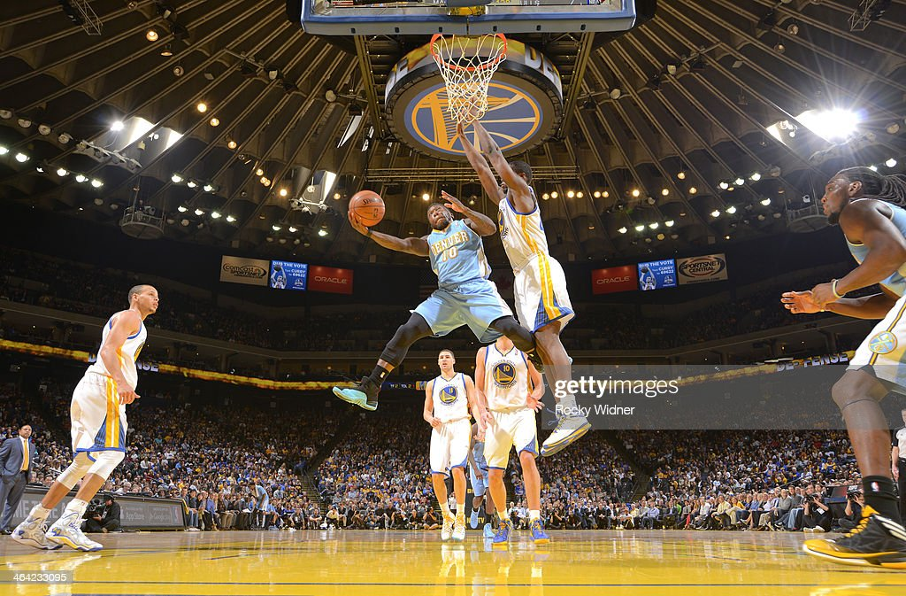 Nate Robinson #10 of the Denver Nuggets drives to the basket against the Golden State Warriors on January 15, 2014 at Oracle Arena in Oakland, California.