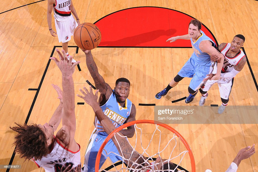 Nate Robinson #10 of the Denver Nuggets drives to the basket against the Portland Trail Blazers on January 23, 2014 at the Moda Center Arena in Portland, Oregon.