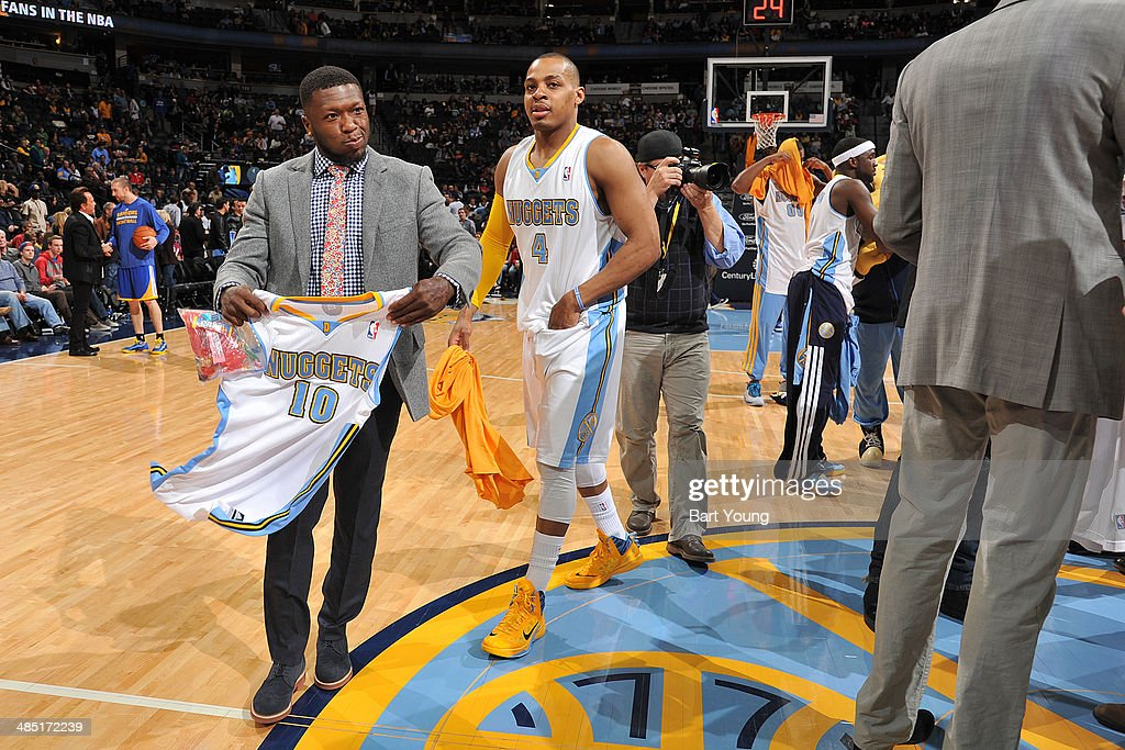 Nate Robinson #10 of the Denver Nuggets gives away a jersey before a game against the Golden State Warriors on April 12, 2014 at the Pepsi Center in Denver, Colorado.